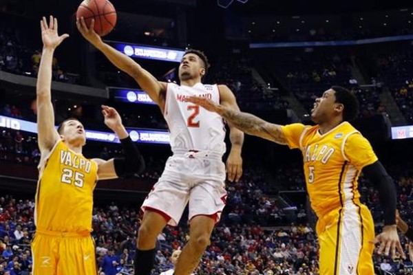 Melo Trimble and the Terrapins won another close game.  (AP Photo/Paul Vernon)