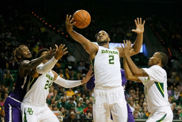 Baylor has the advantage down low, but will their new point guard be able to deliver the ball down low to Rico Gathers? (Tony Gutierrez/AP)