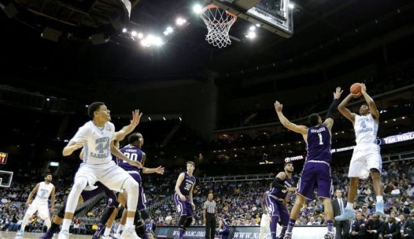 Isaiah Hicks, one of six UNC players to score in double figures, had too much for Northwestern to handle. (AP Photo/Charlie Riedel)