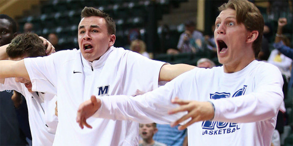 Daniel Pillari, Greg Noack and Monmouth's bench are taking college hoops by storm. (Getty Images)