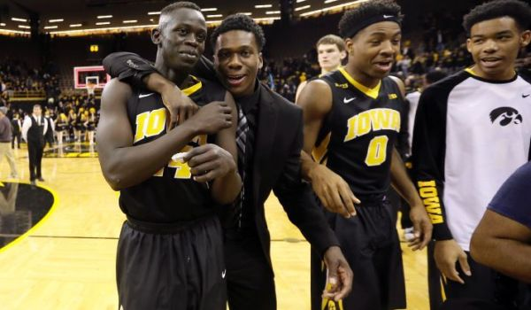 Iowa guard Peter Jok, left, celebrates with teammates after an NCAA college basketball game against Florida State, Wednesday, Dec. 2, 2015, in Iowa City, Iowa. Jok scored 24 points as Iowa won 78-75 in overtime. (AP Photo/Charlie Neibergall)