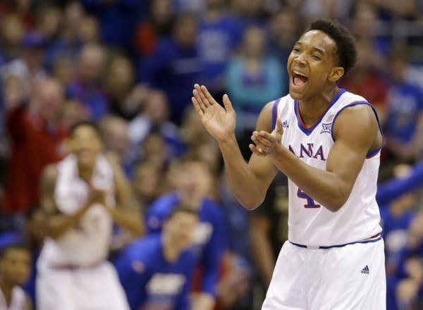 Devonte Graham has brought a number of positive changes to Kansas. (Charles Riedel/The Associated Press)