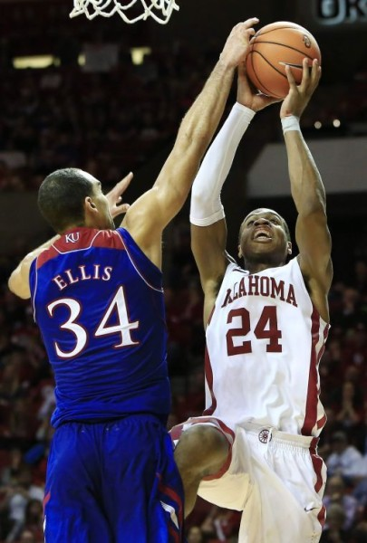 Perry Ellis and Buddy Hield will face one another for the eighth time in their careers. (Alonzo Adams/AP)