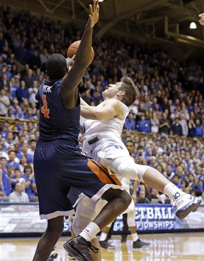 Grayson Allen drives in for his controversial game-winner against Virginia. (AP Photo/Gerry Broome)