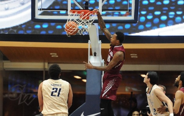 Isaiah Miles slams home two of his 21 points against George Washington. (USATI)