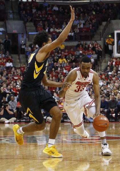 Keita Bates-Diop (right) influenced things offensively and defensively for Ohio State as they knocked off Iowa( Jay LaPrete, AP).