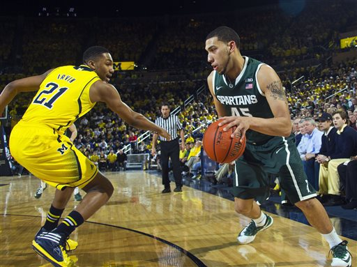 The Michigan-Michigan State rivalry has been must watch TV since John Beilein has arrived in Ann Arbor . (AP Photo/Tony Ding)