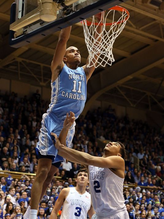 Brice Johnson slams home two of his 18 points as North Carolina dominated Duke in the paint. (Mark Dolejs/USA TODAY Sports)