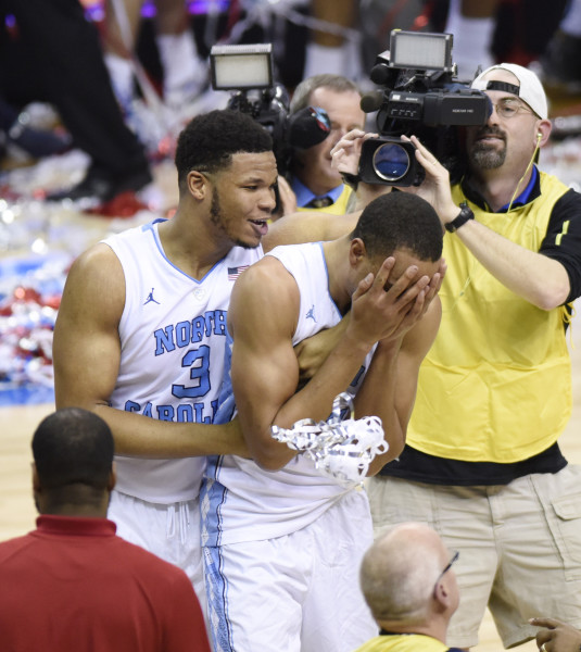 North Carolina forward Kennedy Meeks (3) and North Carolina forward Brice Johnson (11) celebrate winning the championship game of the 2016 New York Life ACC Tournament in Washington, DC, Saturday, March 12, 2016. (Photo by Liz Condo, theACC.com)
