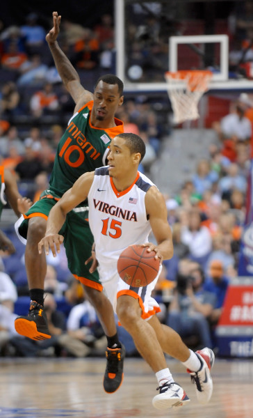 Virginia guard Malcolm Brogdon (15) is pressured by Miami guard Sheldon McClellan (10) during the semifinals of the 2016 New York Life ACC Tournament in Washington DC, Friday, March 11, 2015. (Photo by Sara D. Davis, theACC.com)
