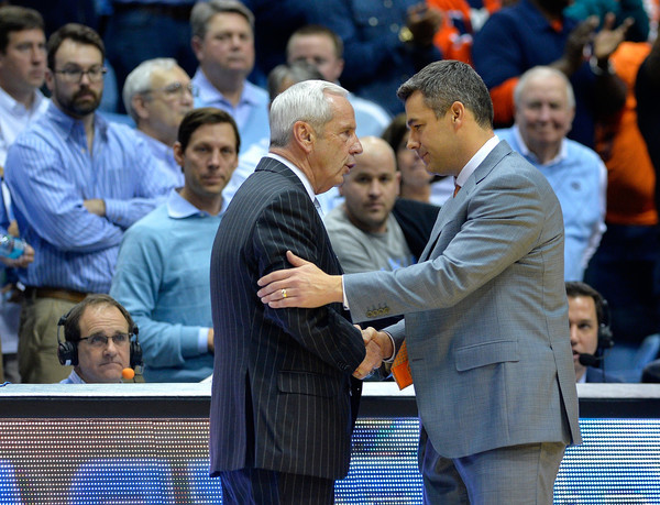 Roy Williams and Tony Bennett each hopes they've earned a #1 Seed in the 2016 NCAA Tournament. (Grant Halverson / Getty Images)