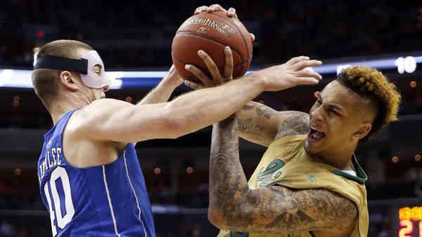 Zach Auguste got the better of his matchup with Marshall Plumlee in Notre Dame's win over Duke. (photo: Alex Brandon, AP)