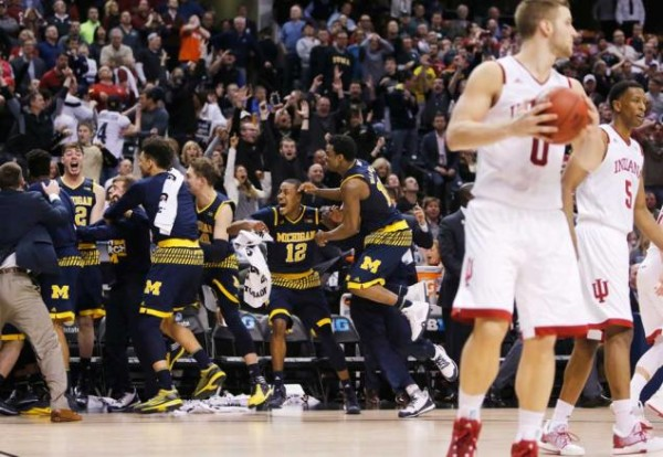 Michigan reserve Kameron Chatman preserved the Wolverine's NCAA Tournament hopes on Friday (KIICHIRO SATO, NY Daily News)