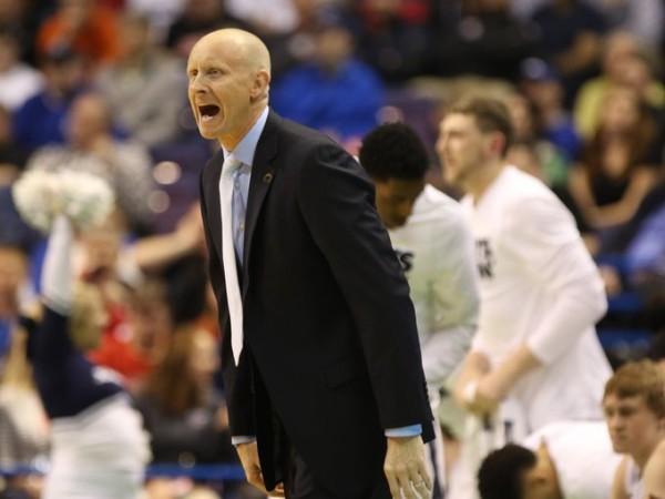 Xavier head coach Chris Mack urges his Musketeers on in Friday night's win over Weber State. (Cara Owsley/The Cincinnati Enquirer)