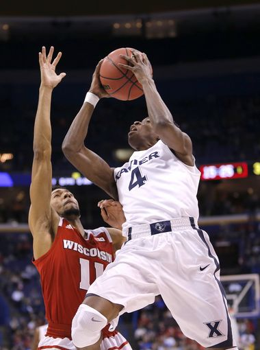 Xavier's Edmond Sumner tries to outmaneuver Wisconsin's Jordan Hill in Sunday night's game. (Cara Owsley/Cincinnati Enquirer)