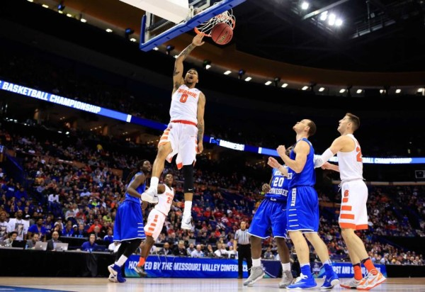 Syracuse's Michael Gbinije rises for a highlight dunk on Sunday night. (Jamie Squire/Getty Images)