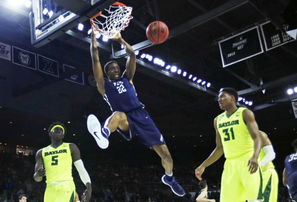 Yale's Justin Sears slams one home during the first half against Baylor. (Credit: AP/ Charles Krupa)