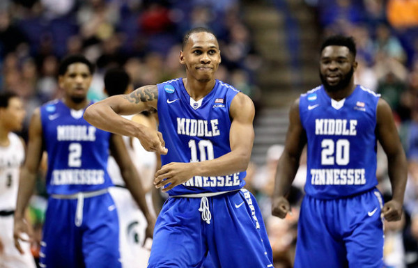 Middle Tennessee State's Jaqawn Richmond gets the celebration going for his Blue Raiders. (Charlie Riedel/Associated Press)