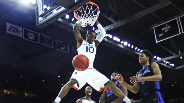 Miami's Sheldon McClellan finishes a dunk in the first half. (Credit: Charles Krupa/AP)