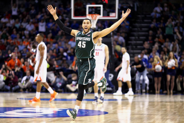As they did in 2014, Denzel Valentine and Michigan State ended Virginia's season last March. Will they do it yet again this year? (Photo: mlive.com/Mike Mulholland)