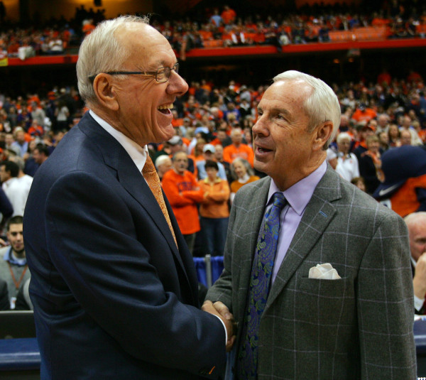 Syracuse head coach Jim Boeheim, left, and North Carolina head coach Roy Williams, right, greet each other before for the start of an NCAA college basketball game in Syracuse, N.Y., Saturday, Jan. 11, 2014. Syracuse won 57-45. (AP Photo/Nick Lisi)