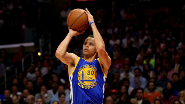 Stephen Curry's long range bombing represents the new stlye of basketball that's already changing the college game. (Credit: www.sportingnews.com)