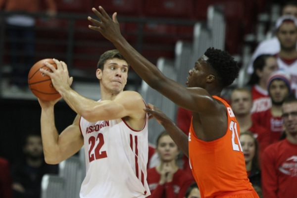 Ethan Happ (right) had a game-high 24 points in Wisconsin's 77-60 win over Syracuse on Tuesday night. (USA Today Images)