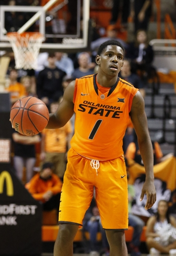 Oklahoma State Cowboys guard Jawun Evans has put up video game numbers so far this season: 23.3 ppg, 4.0 rpg, 6.3 apg and 3.0 spg. (Alonzo Adams/USA TODAY Sports)