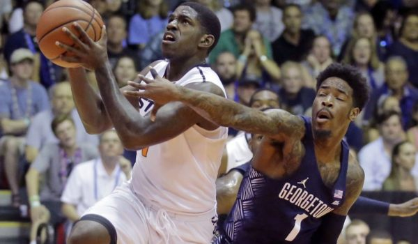 Look for Oklahoma State's Jawun Evans (left) to leave a few more opponents in his dust before the end of the 2016-17 season. (AP/Rick Bowmer)