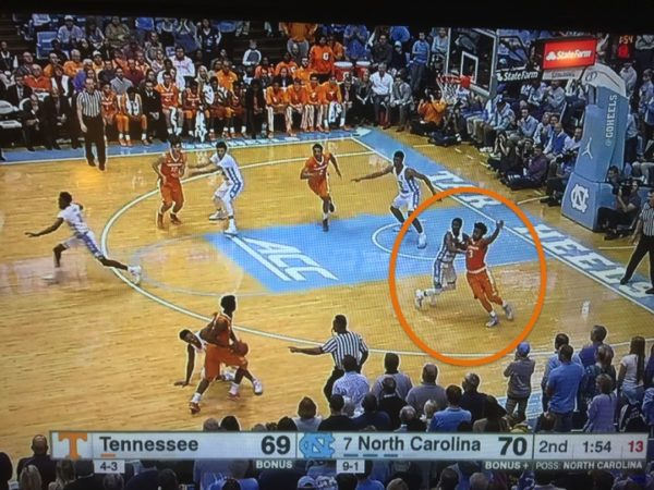 UNC's Kenny Williams plays great defense to deny Hubbs the entry pass.
