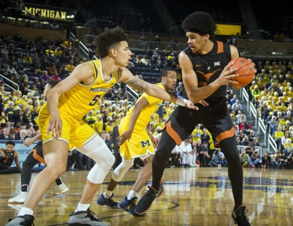 D.J. Wilson remains key to the Wolverines' success. (AP Photo/Tony Ding)